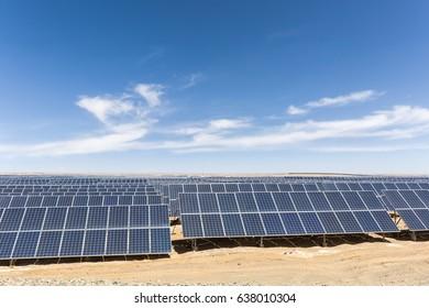 solar panels on the gobi against abundant sunshine sky, new energy background
