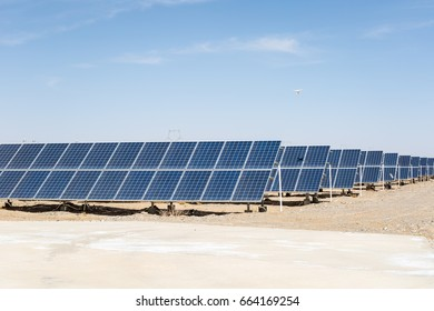 solar panels on the gobi desert, clean energy against a blue sky