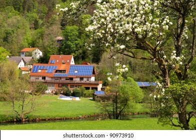 Solar panels on house and barns of privately owned farm in Frankonian Switzerland, Bavaria, Germany