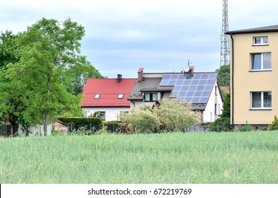 Solar panels on the house roof. Urban landscape with modern technology.