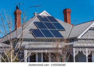 Solar panels on a red roof in a suburban setting, Melbourne, Australia