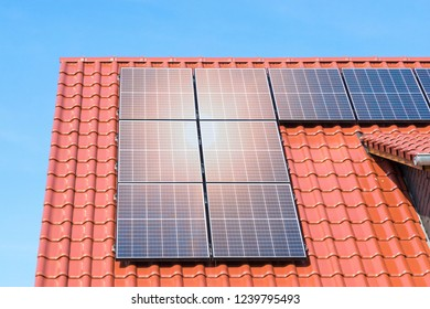 solar panels on a red tiled roof - photovoltaic power plant