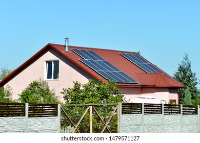 Solar panels on the roof of a country house, environmental production of solar energy in electrical.