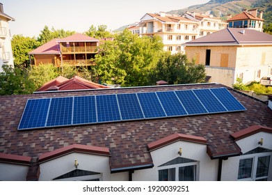 Solar panels on the roof of a country house.