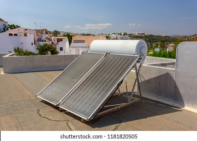 Solar panels on the roof of the house, for heating water.