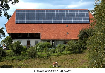 Solar panels on the roof of a house on a farm