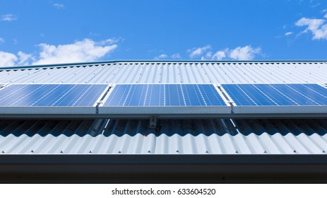 Solar panels on the roof of a house on a bright, sunny day