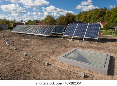 Solar panels on the roof of the modern building. Grass roof.