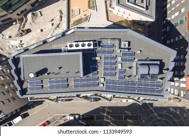 Solar panels on the roof of the multi-family houses, aerial view