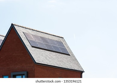 solar panels on roof of new houses in england uk on bright sunny day