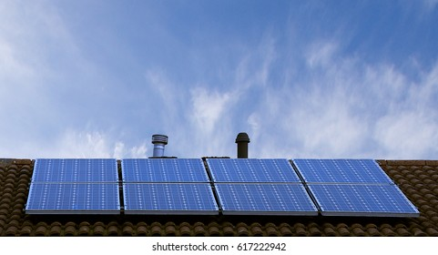 Solar panels on roof top, blue sky