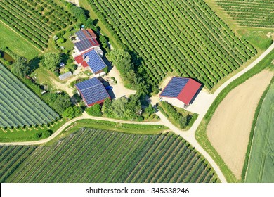 solar panels on the roofs of rural houses in Germany