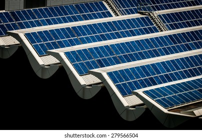 Solar panels on rooftop. Banks of solar panels on rooftop of a building. Scientific, Technology, and Engineering solution to tapping electrical energy from the sun. Go Green!