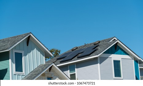 Solar panels on rooftop of Modern homes and houses in nice luxury new development neighborhood suburb in Austin, Texas, USA a clean renewable sustainable future with blue sky background