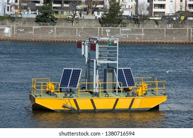 Solar panels on a sign and light floater on the Moselle River