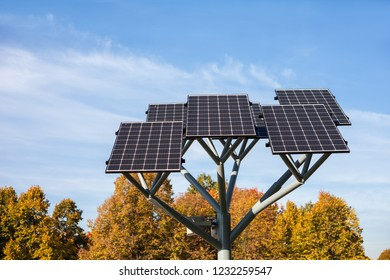 Solar panels on a stand in city park, photovoltaic modules, sustainable renewable energy source
