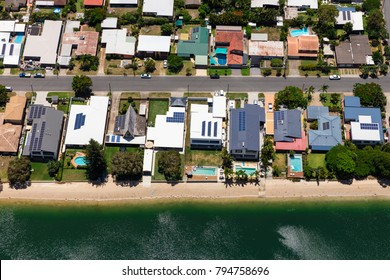 Solar panels on suburban waterfront homes, Australia