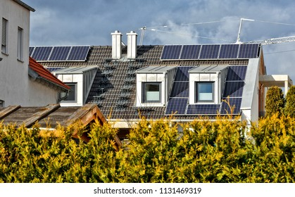 Solar panels on a tile roof. Close up. Housetop. Alternative energy. Modern residential house. Contemporary accommodation.
