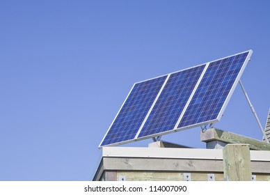 Solar panels on top of a roof.