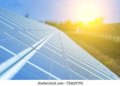 Solar panels, photovoltaic, alternative source environmentally friendly energy. In the backlight sunbeam light.
