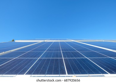 Solar panels with photovoltaic  modules for renewable energy with blue sky
