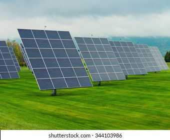Solar panels placed on a countryside meadow.