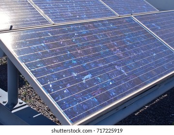 Solar panels or Polycrystalline Silicon Solar cells on rooftop or terrace of building in Cape Town, South Africa. Green or Sun or renewable or Clean energy. Saving energy, Zero Emission concept.