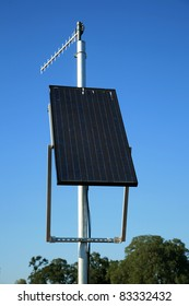 solar panels produce electricity for a transmitting beacon at a remote location where other forms of electricity do not exist