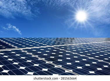 Solar panels produce energy from the sun with blue sky