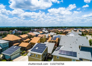 Solar panels provide cheap , clean , and renewable energy . Real estate homes with Solar Panel Rooftops A Clean Renewable Neighborhood for the future in Austin , Texas , USA