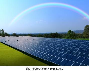 Solar panels with rainbow sky, Solar power plant with beautiful rainbow background