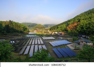 Solar panels reflect the early morning sky at in rural Japan