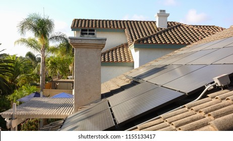 Solar panels in a Southern California residential installation show dust and dirt after a long dry summer