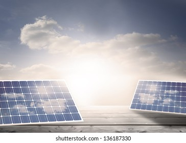 Solar panels standing on floorboards in the cloudy blue sky