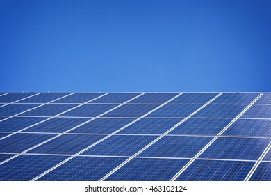 Solar panels in sunshine and blue sky