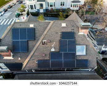 Solar panels system on the house roof in the city. Technology for alternative energy concept.