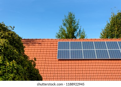 Solar panels at the top of a family house.