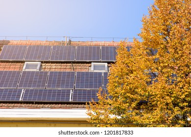 Solar panels at the top of the family house in the autumn