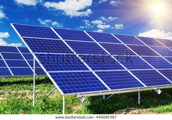 solar panels under blue sky and sunlight