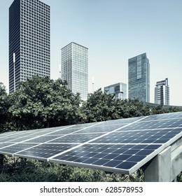 Solar panels and urban construction background