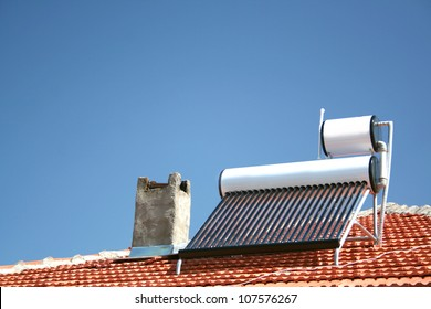 solar panels with water collector on the roof of house
