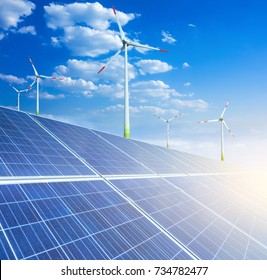 Solar panels and wind generators turbines. Alternative source environmentally friendly energy. In the backlight sunbeam light.