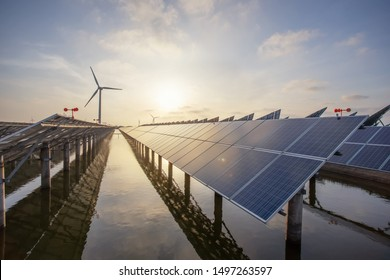 Solar panels and wind power, clean energy in nature - Shutterstock ID 1497263597