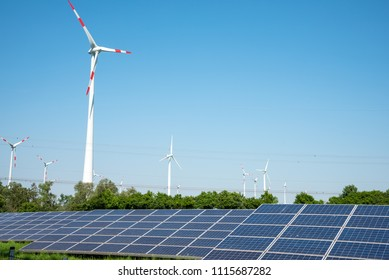 Solar panels, wind power plants and overhead lines seen in Germany