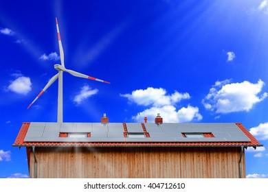 Solar panels and wind turbine against a sunny sky.