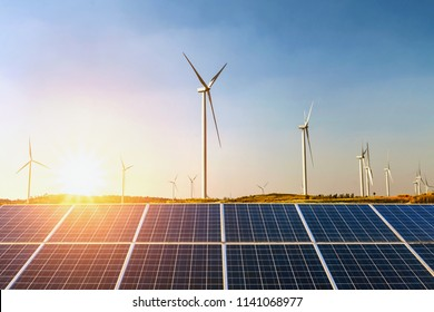 solar panels and wind turbine with sunset on the hill. concept idea clean energy
