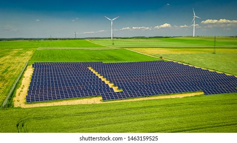 Solar panels and wind turbines, aerial view of Poland