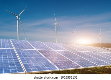 solar panels with wind turbines against blue sky background. Photovoltaic, alternative electricity source. sustainable resources concept.