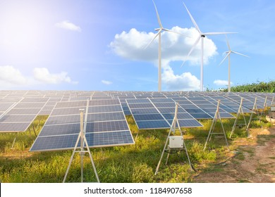 Solar panels with wind turbines landscape blue sky with clouds