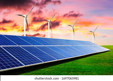 Solar panels with wind turbines in the setting sun,green energy.